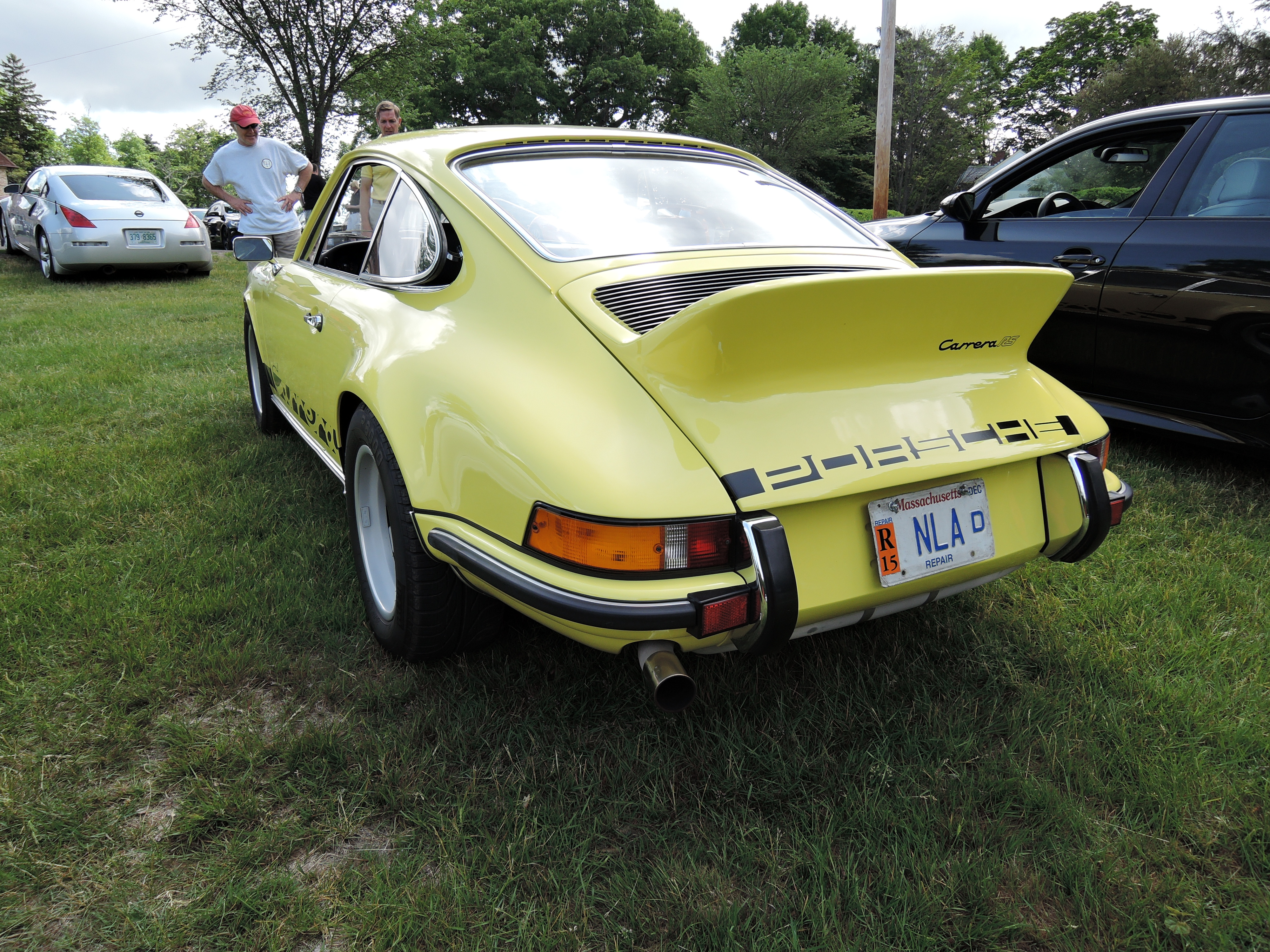 yellow porsche 911 Carrera RS - cars and coffee car show at larz Anderson museum of transportation