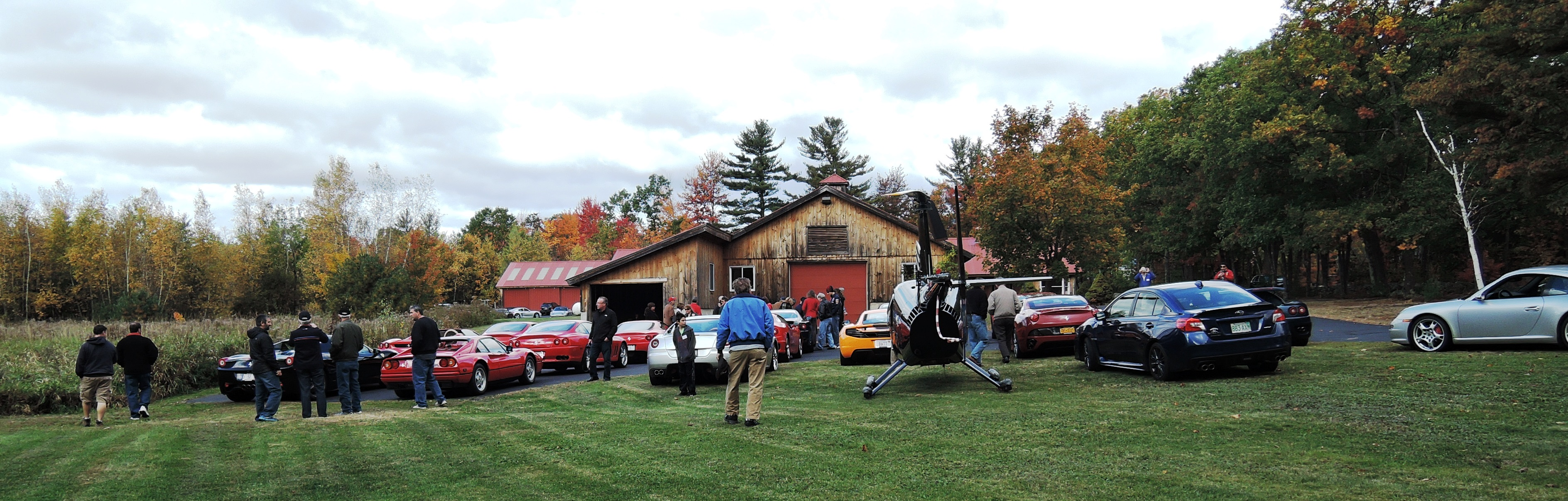 car collection in NH - helicopter and ferraris