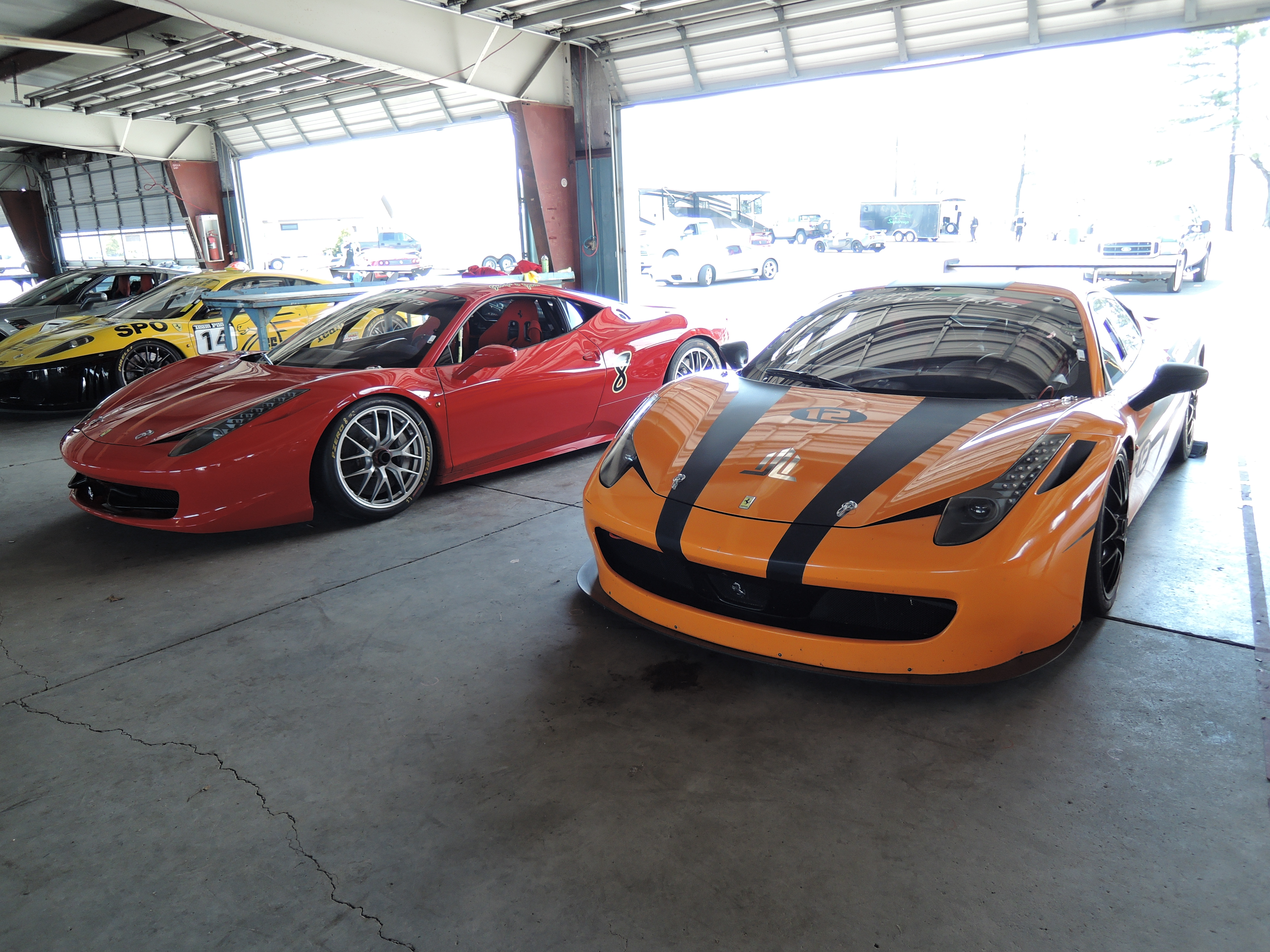 red and orange Ferrari 458 Challenge Cars - watkins gln