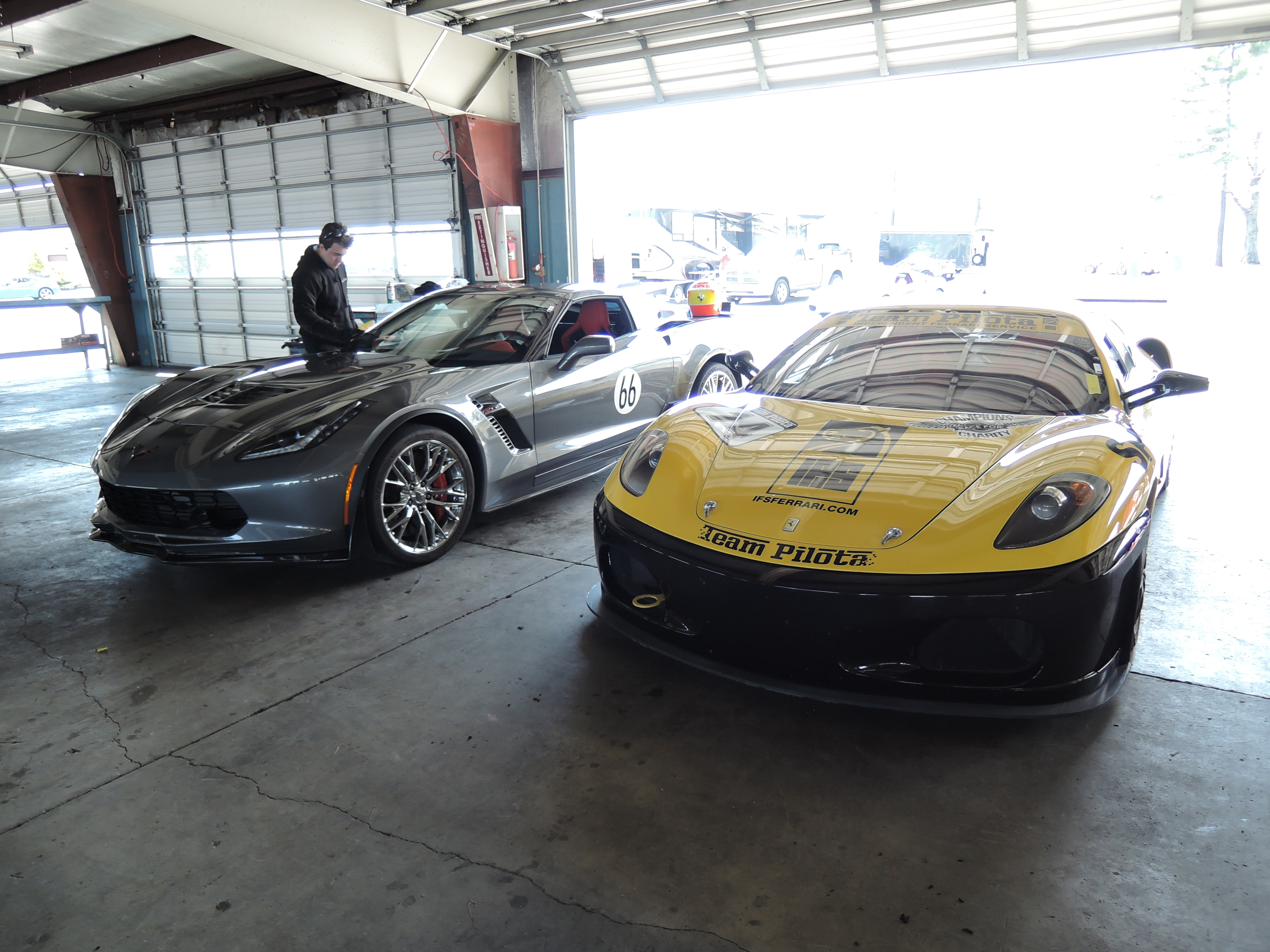silver Corvette and yellow Ferrari 430 - watkins glen