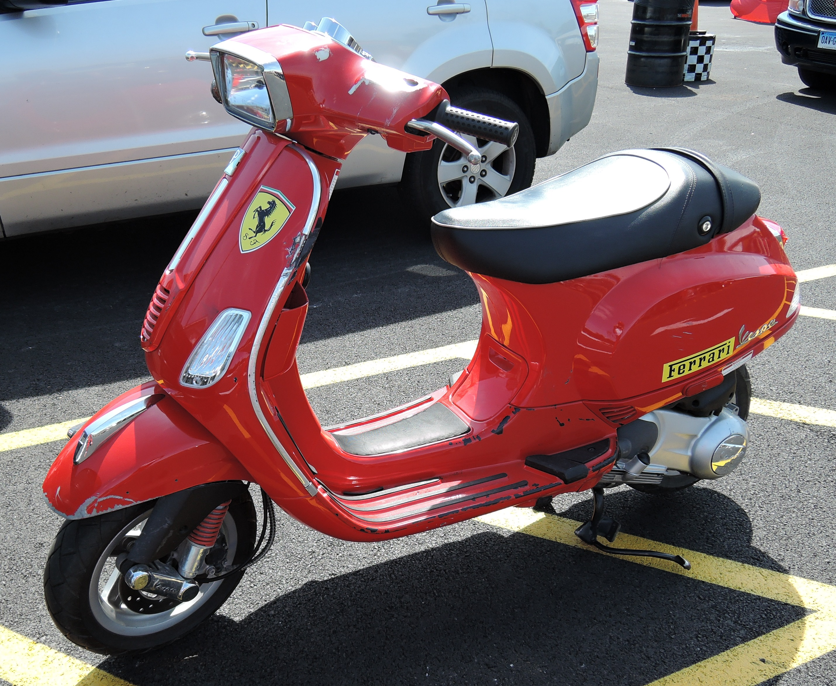 red ferrari scooter - lime rock park
