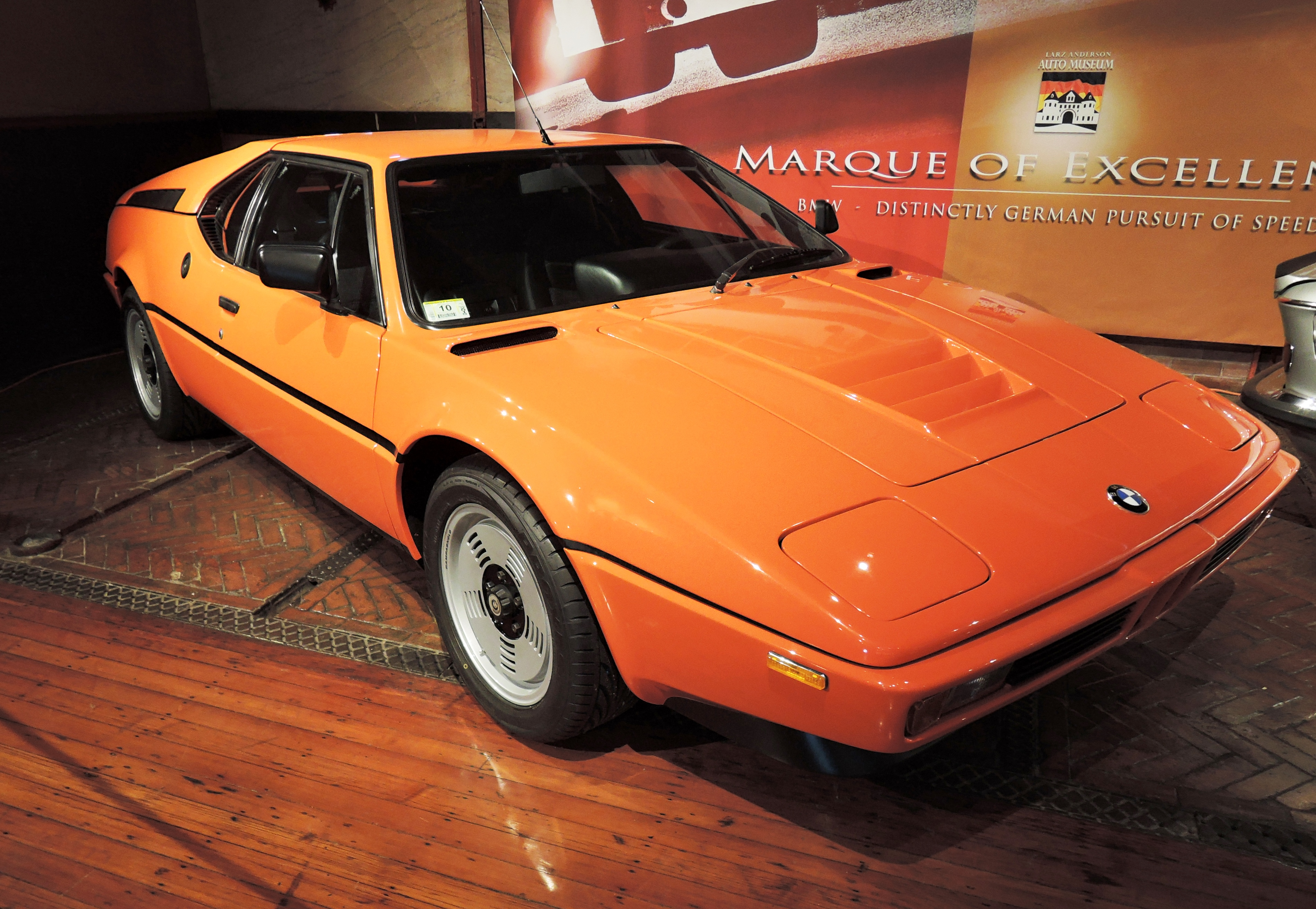 orange 1980 BMW M1 - cars and coffee at larz