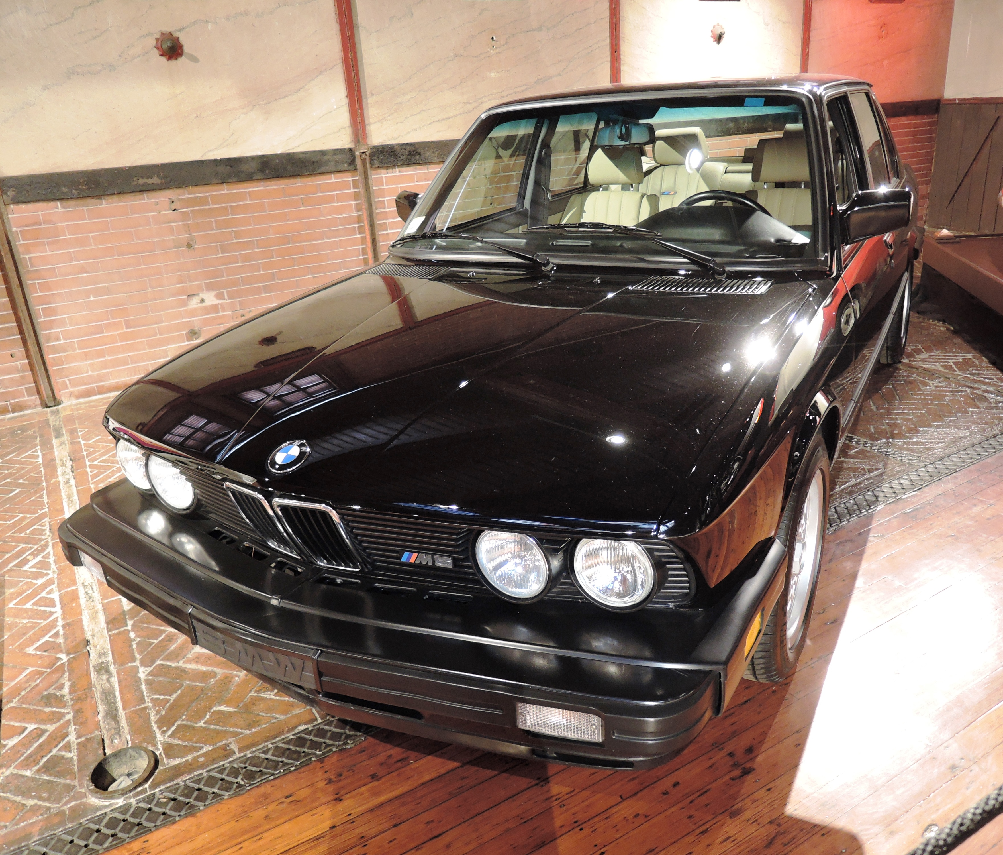 black 1988 BMW E28 M5 - cars and coffee at larz