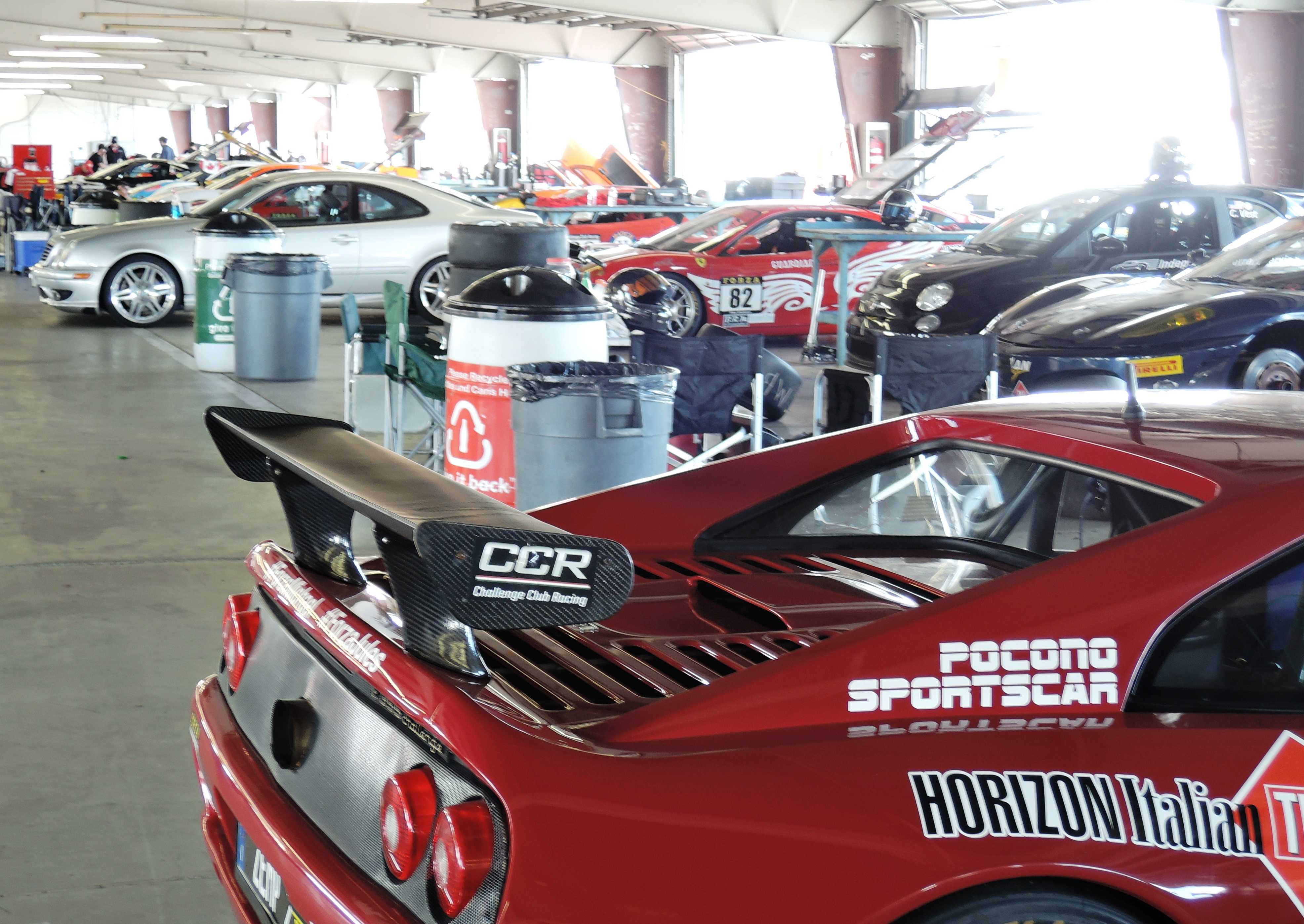 ferrari challenge cars in the garages at ferrari club - watkins glen